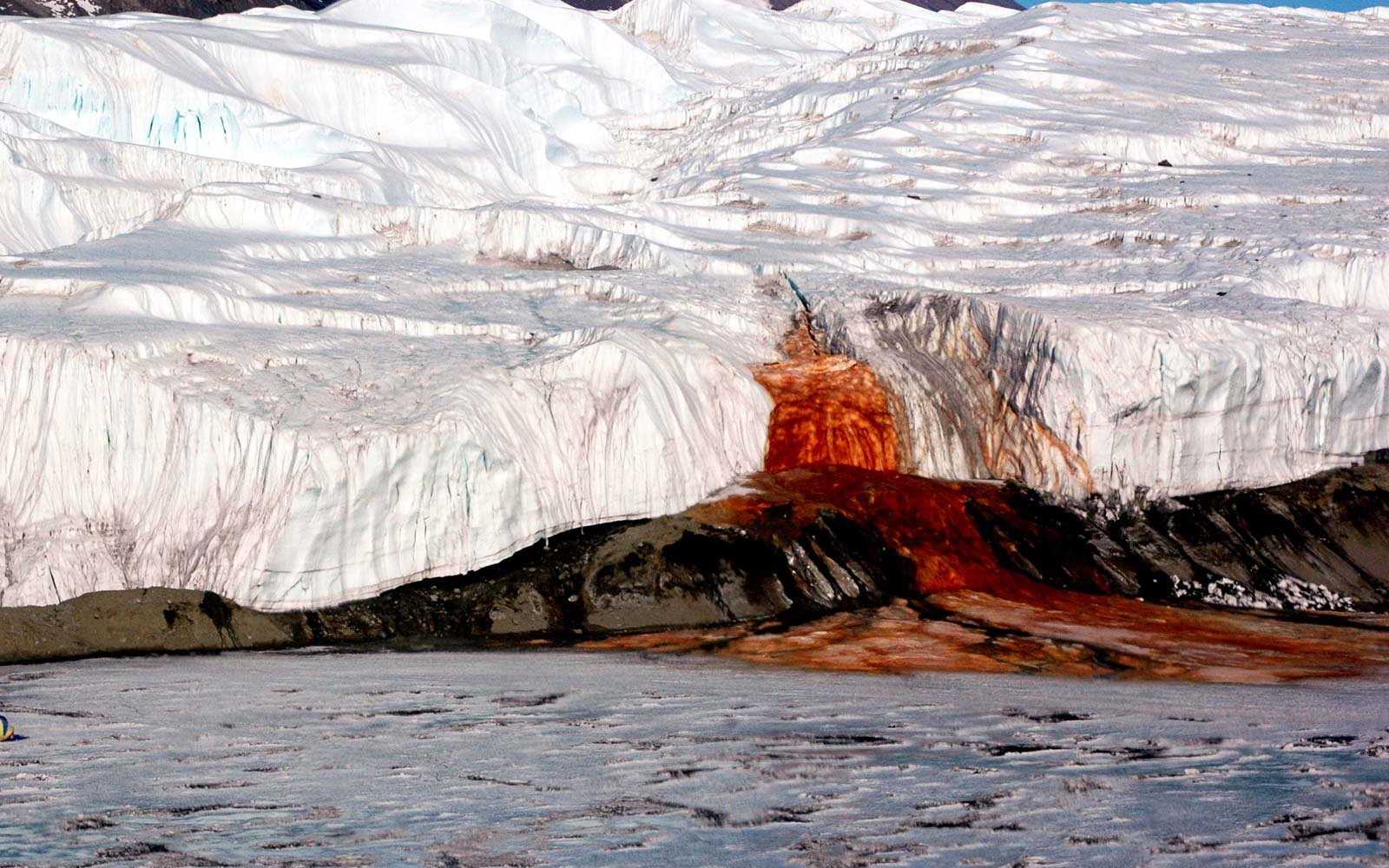 The Blood Falls seeps from the end of the Taylor Glacier into Lake Bonney, Antarctica