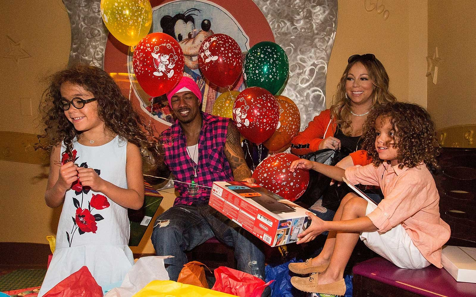 Monroe Cannon, Nick Cannon, Mariah Carey, and Moroccan Cannon celebrate the twins birthday at Disneyland