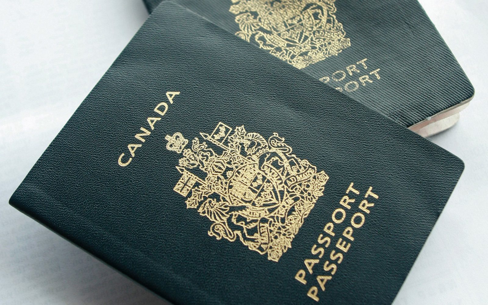 CANADA - JANUARY 22:  Canadian passports are arranged for a photograph in Big White, Canada, on Monday, Jan. 22, 2007, in Canada.  (Photo by Norm Betts/Bloomberg via Getty Images)