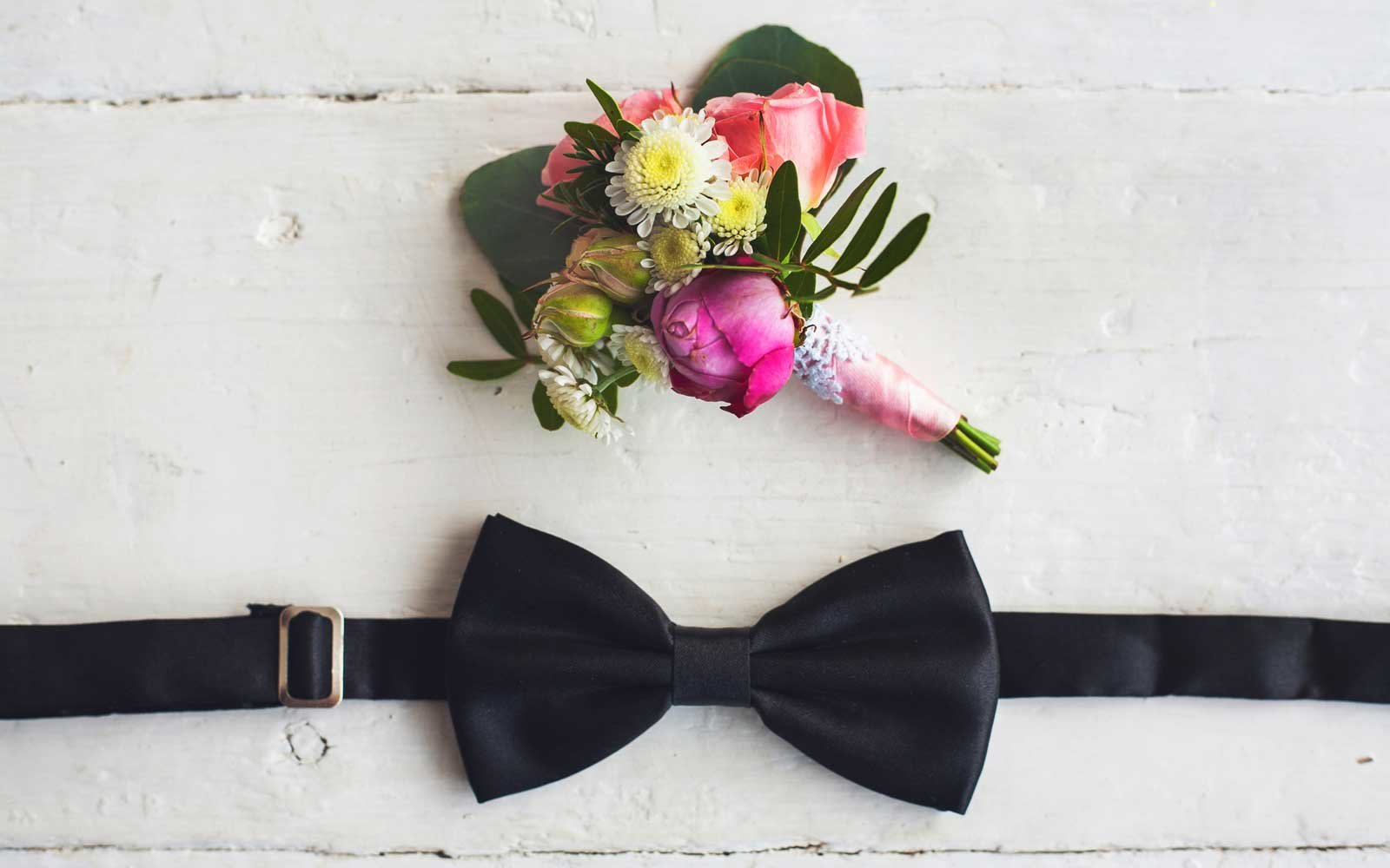 Black bowtie and flower boutonniere