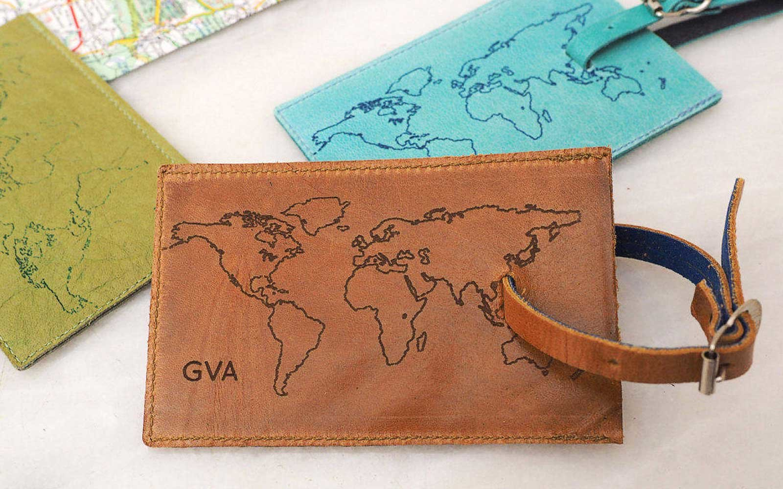 18 luggage tags fancier than the paper one you got for free at the world map leather luggage tag gumiabroncs Gallery