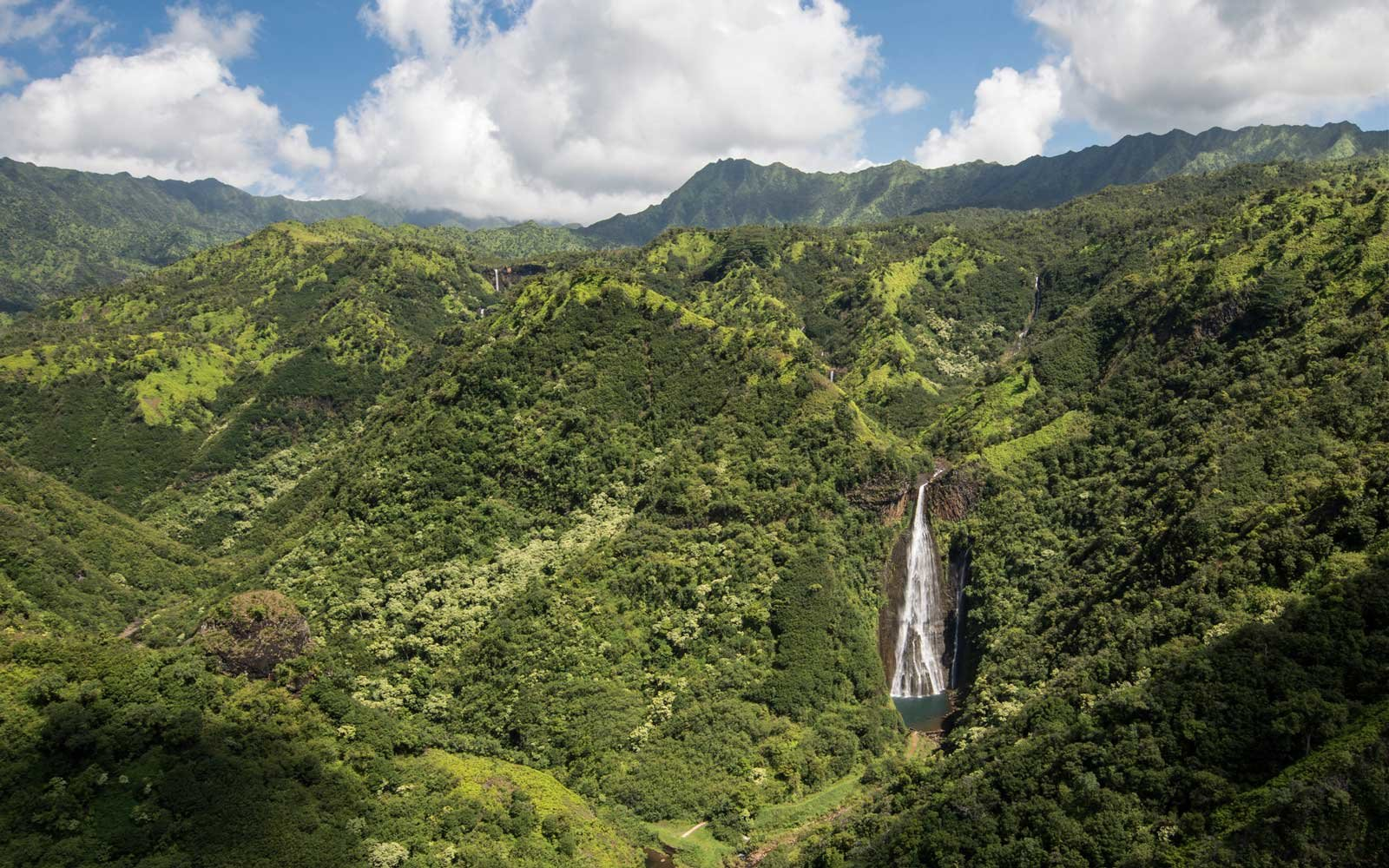 Aerial view of waterfall Manawaiopuna Falls, used in Jurassic park, Kauai, Hawaii