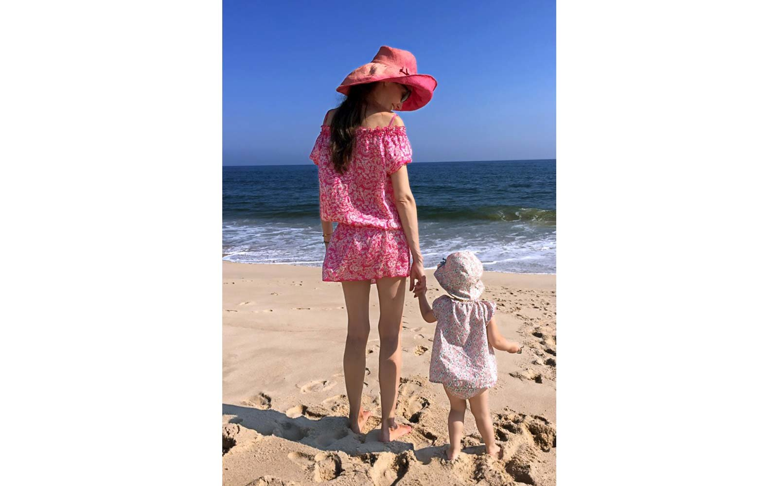 Olivia Chantecaille and child on beach