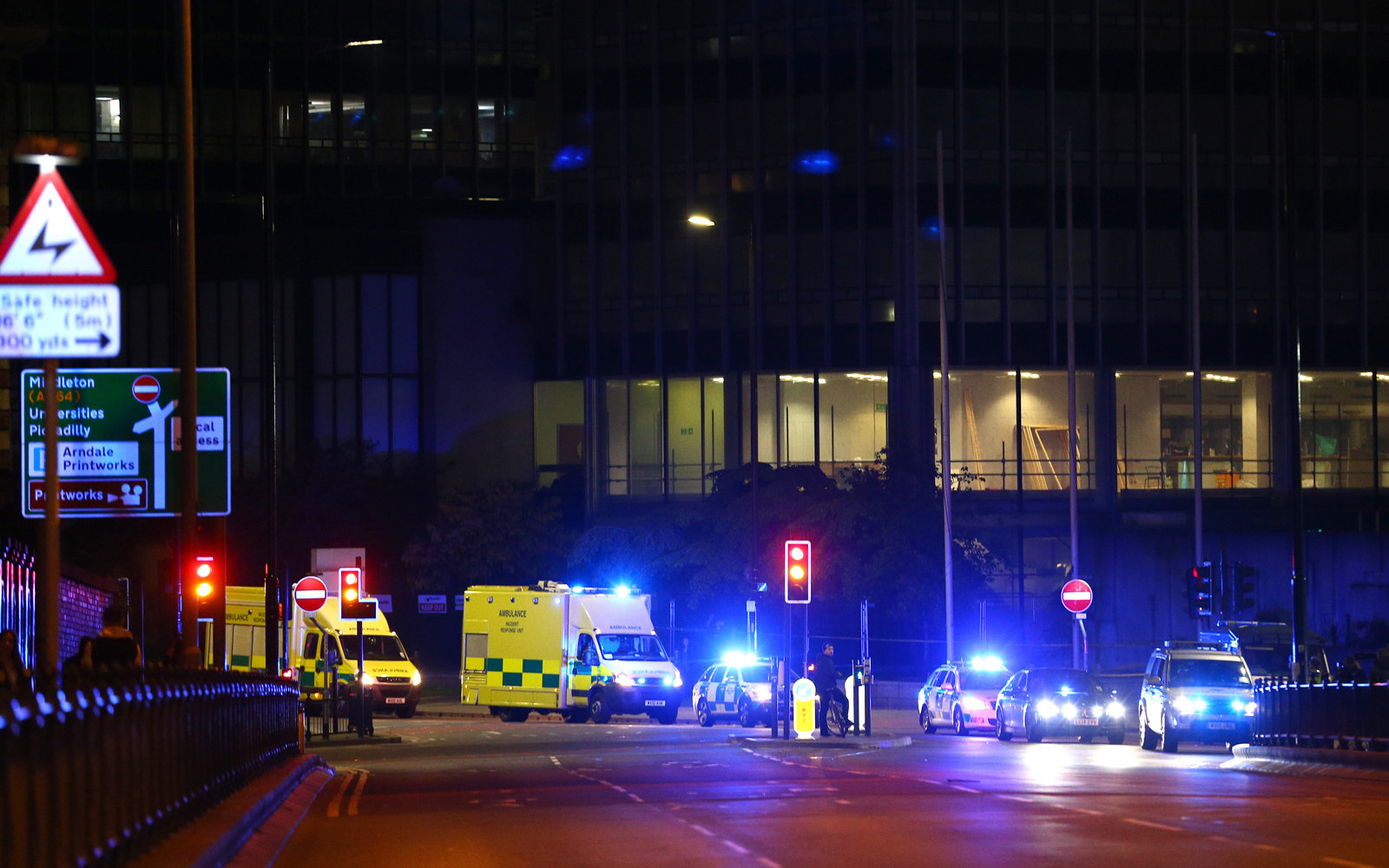 Police and medics respond to an explosion at Manchester Arena after an Ariana Grande concert on May 22, 2017.