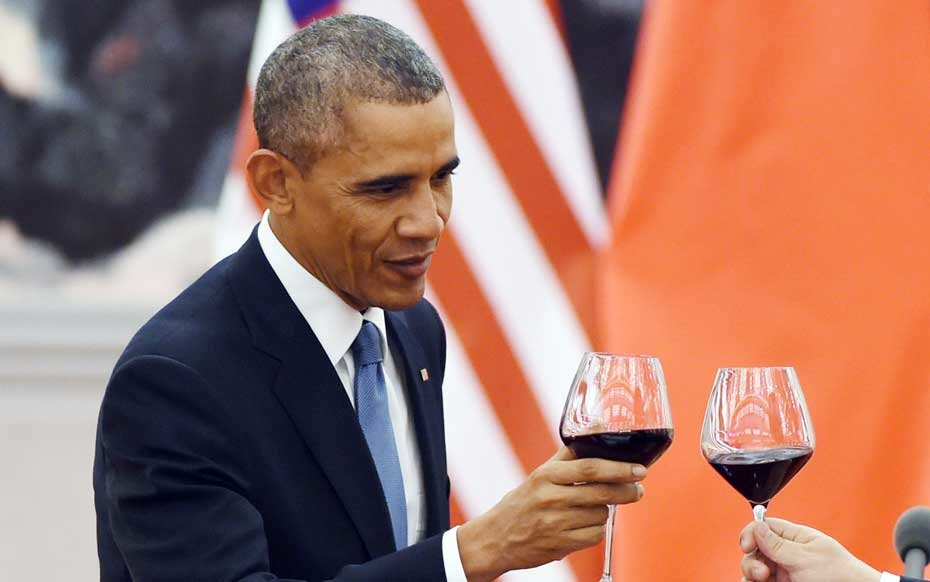 Obama drinks wine