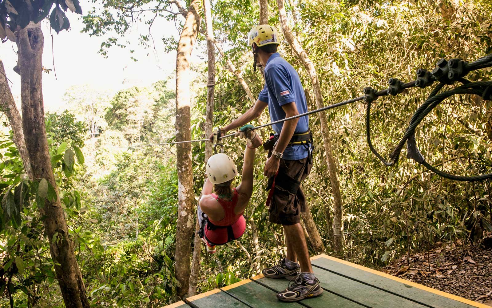 Go zip-lining in the rain forest of Costa Rica