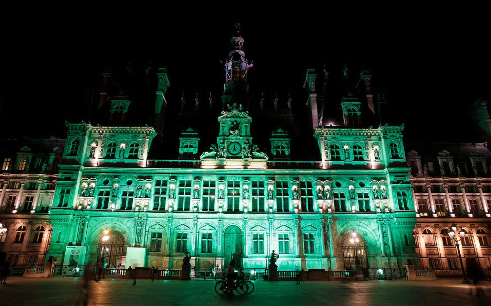 PARIS, FRANCE - JUNE 01:  The Paris city Hall is illuminated in green following the announcement by US President Donald Trump that the United States will withdraw from the 2015 Paris accord on June 01, 2017 in Paris, France.  U.S. President Donald Trump a
