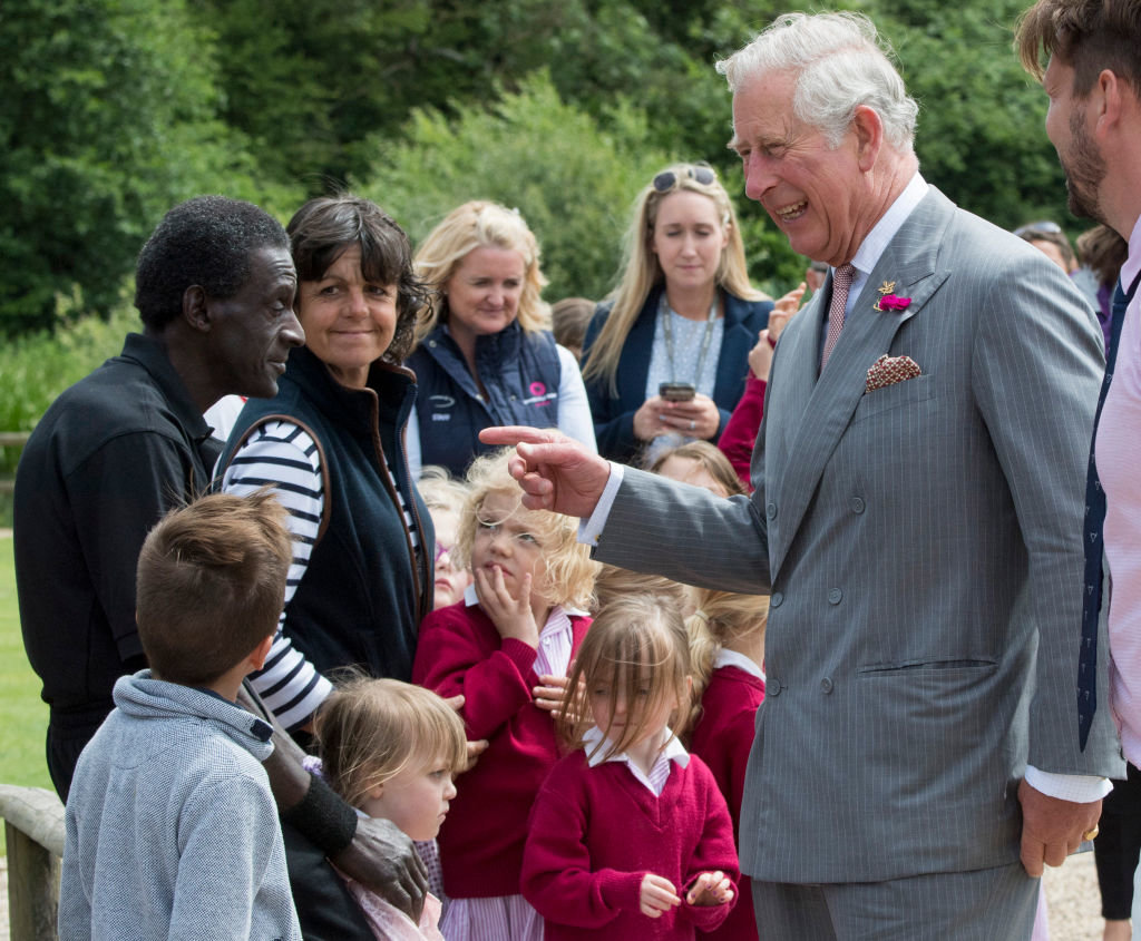 Prince Charles with a group of children.