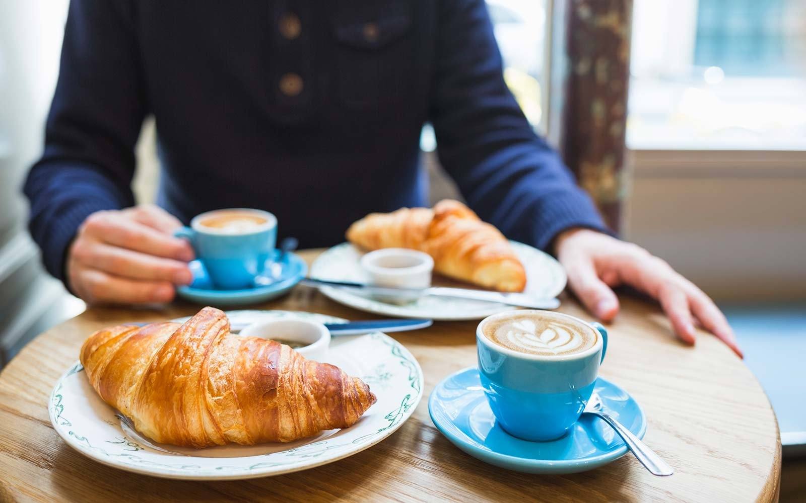 Coffee and croissant French breakfast Paris
