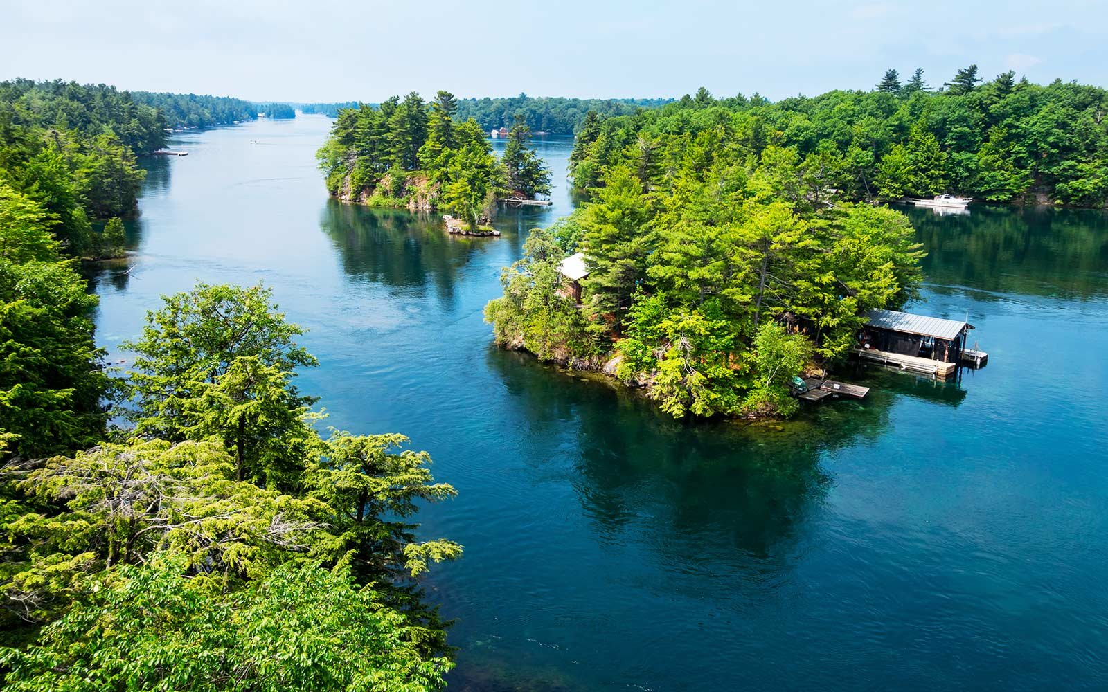 St Lawrence River and islands with cottages at Thousand Islands National Park, located between Ontario Canada and New York State USA.
