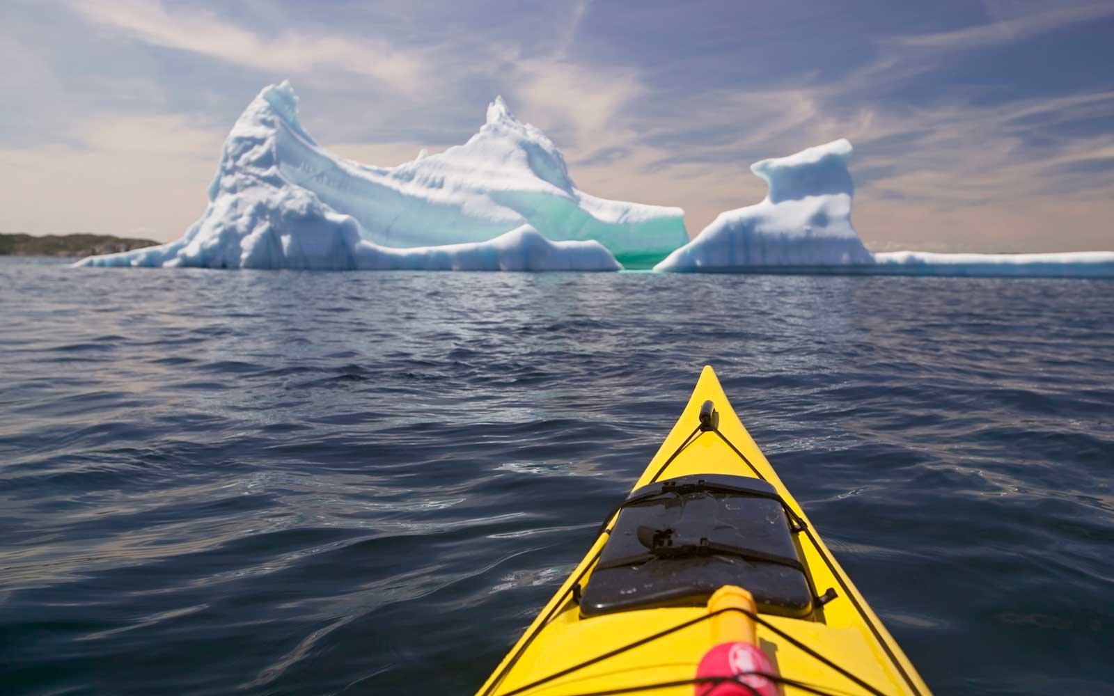 Kayaking with Iceberg, near Merritt's Habour, close to Twillingate, Kittiwake Coast, Newfoundland, Canada.
