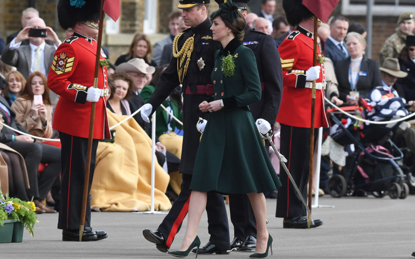 LONDON, ENGLAND - MARCH 17: Catherine, Duchess of Cambridge and Prince William, Duke Of Cambridge present the 1st Battalion Irish Guardsmen with shamrocks during the annual Irish Guards St Patrick's Day Parade at Household Cavalry Barracks on March 17, 20