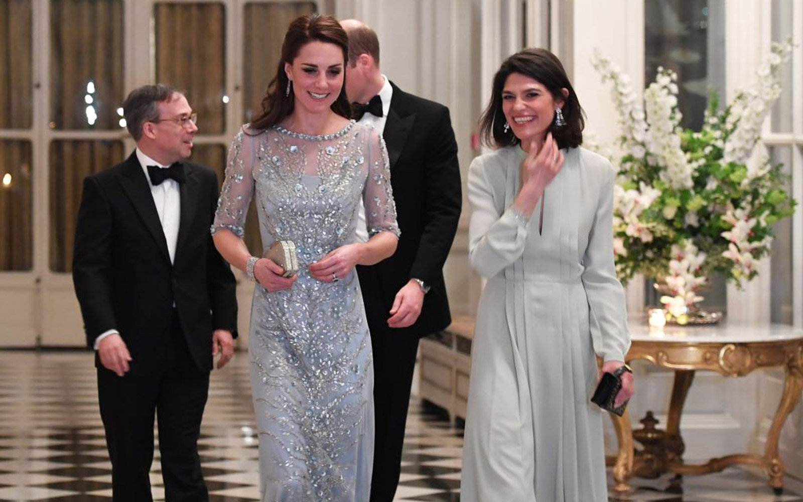 British Ambassador Edward Llewellyn (L) and his wife walk with Britain's Prince, the Duke of Cambridge, and Kate (2nd L), the Duchess of Cambridge, before a diner at the British Embassy in Paris on March 17, 2017. British royals William and Kate arrived