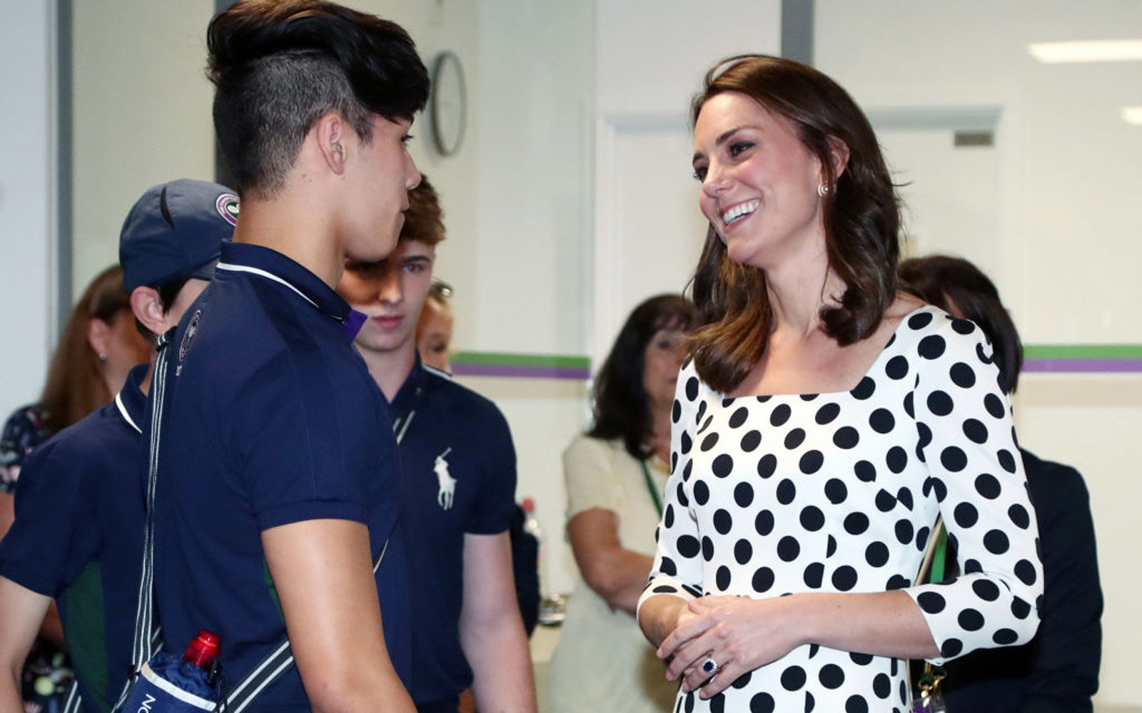 LONDON, UNITED KINGDOM - JULY 3:  Catherine, Duchess of Cambridge, Patron of the All England Lawn Tennis and Croquet Club (AELTC) as she meets ball boys and girls on day one of the Wimbledon Championships at The All England Lawn Tennis and Croquet Club, W