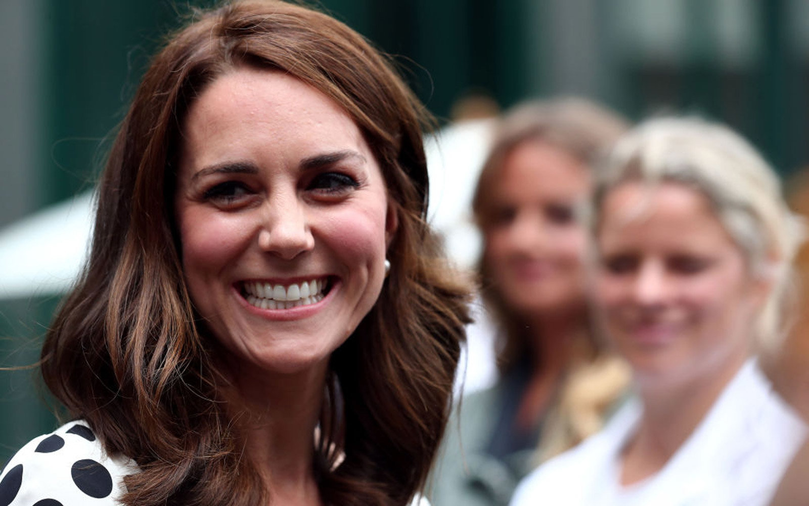 Britain's Catherine, Duchess of Cambridge, smiles as she meets former players, servicemen and servicewomen as she visits The All England Lawn Tennis Club in Wimbledon, south-west London, on July 3, 2017 on the first day of the 2017 Wimbledon Championships