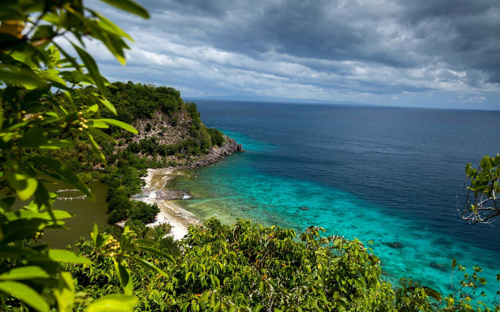 View from top of a hill to Apo Reef Natural Park. Apo island, Philippines