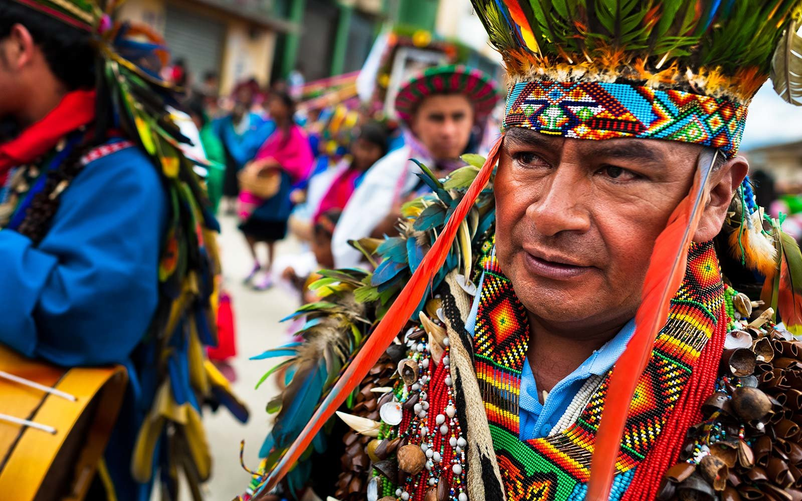 Putumayo Kamentsa shaman, wearing a colorful costume, takes part in the Carnival of Forgiveness in Sibundoy Colombia Style Travel Fashion Guide