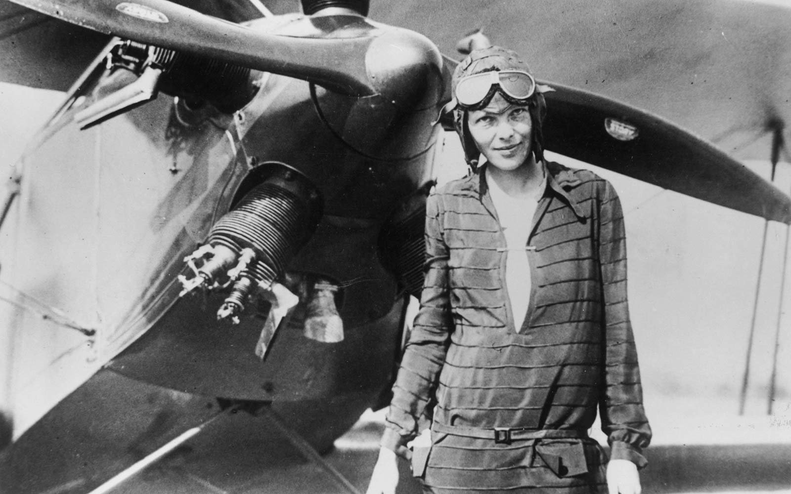 """Amelia Earhart in front of her bi-plane called """"Friendship"""" in Newfoundland"""