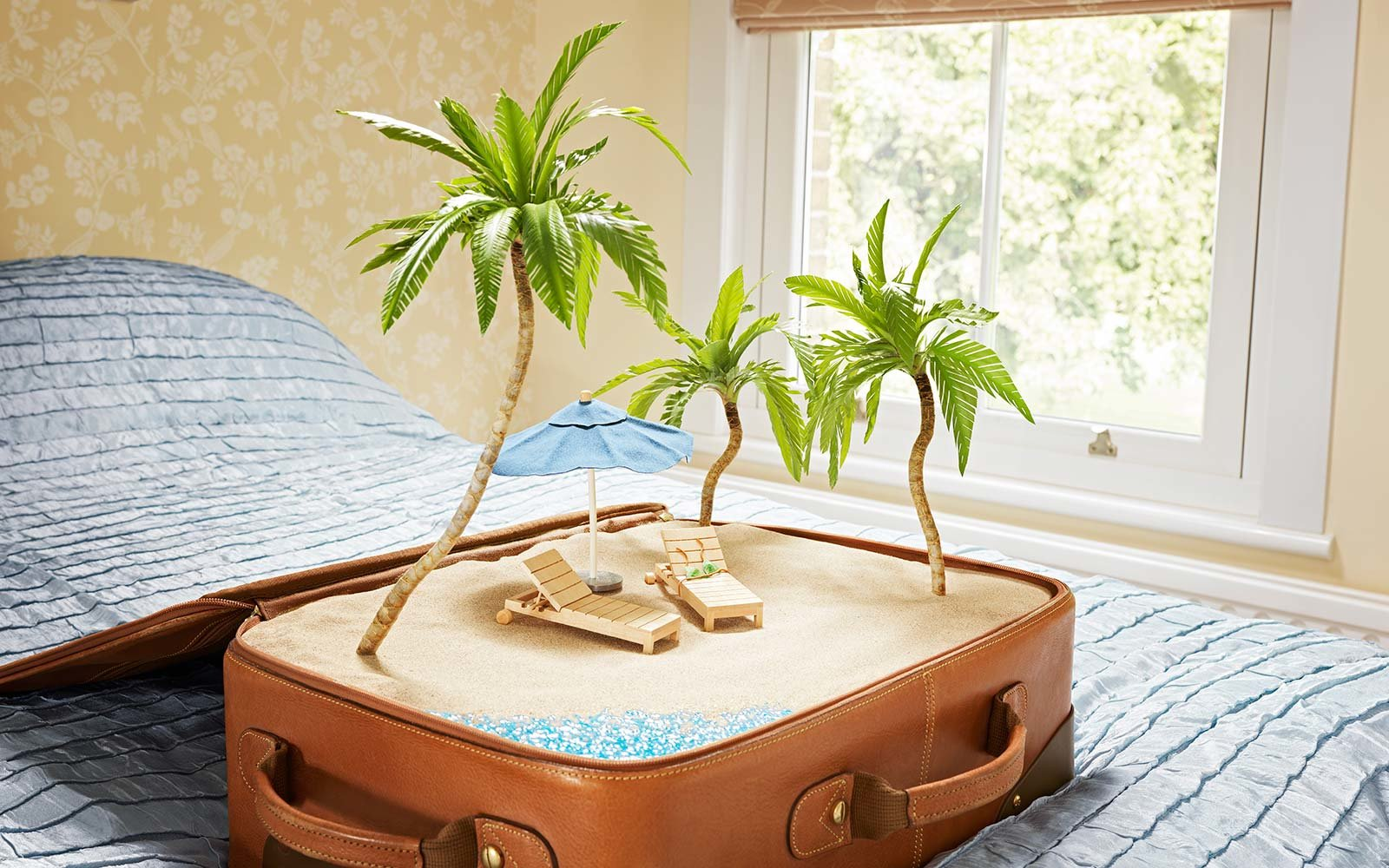tropical beach scene inside a suitcase, palm trees, adventure, beach, bedroom, Happiness, Healthy Lifestyle, holidays, palm trees, paradise, parasol, sand, sea, suburban home, suitcase, Summer, sun loungers, tropical, Vacations