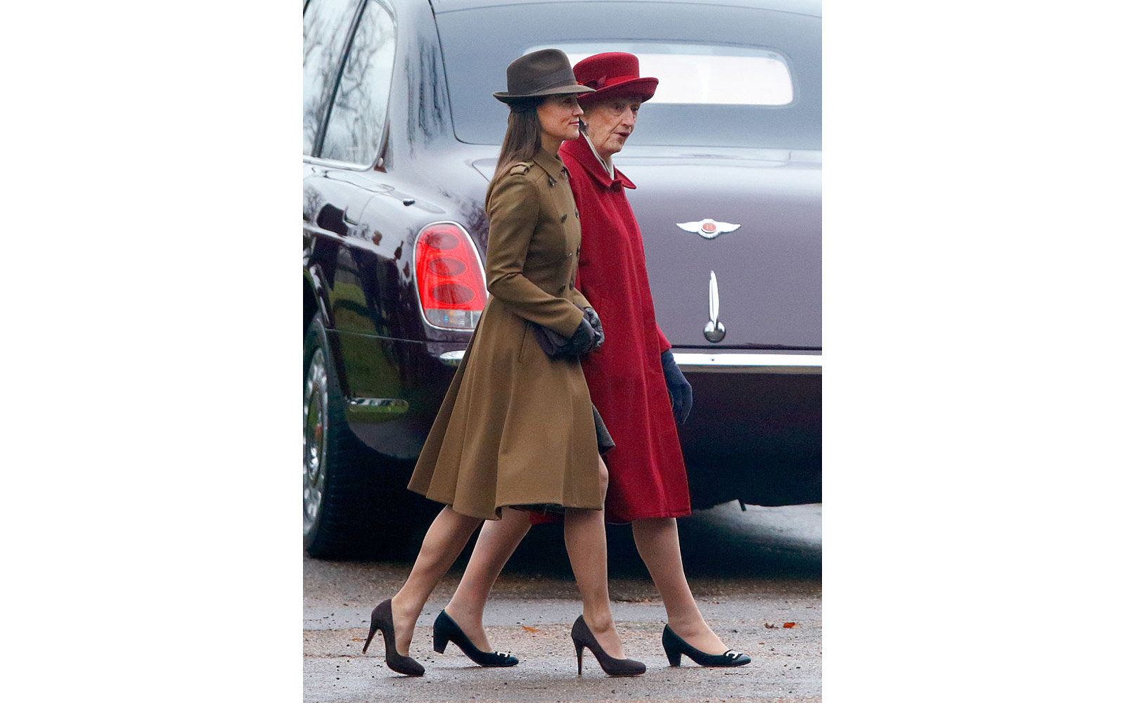 KING'S LYNN, UNITED KINGDOM - JANUARY 08: (EMBARGOED FOR PUBLICATION IN UK NEWSPAPERS UNTIL 48 HOURS AFTER CREATE DATE AND TIME) Pippa Middleton and Lady Susan Hussey (Lady in Waiting to Queen Elizabeth II) attend the Sunday service at St Mary Magdalene C