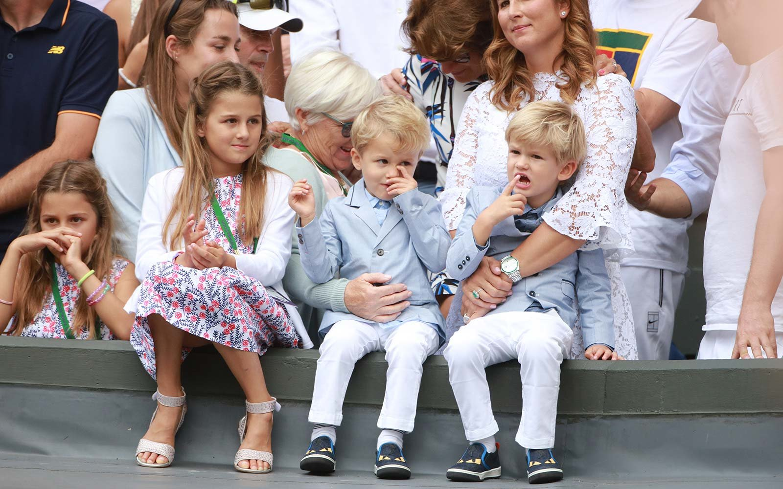 Roger Federer's wife Mirka Federer and their four children, identical twin daughters Myla and Charlene, 7, and identical 3-year-old twin sons Leo and Lenny, cheer from the stands at Wimbledon tennis