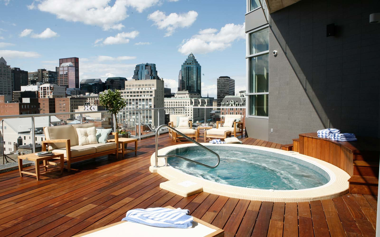 25 rooftop pools to dream about while you sit in the for Great small hotels