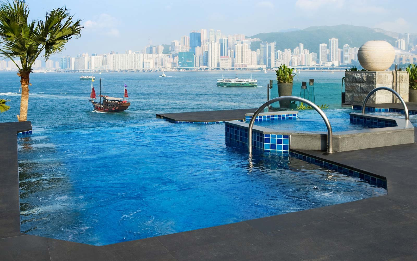 25 Rooftop Pools To Dream About While You Sit In The