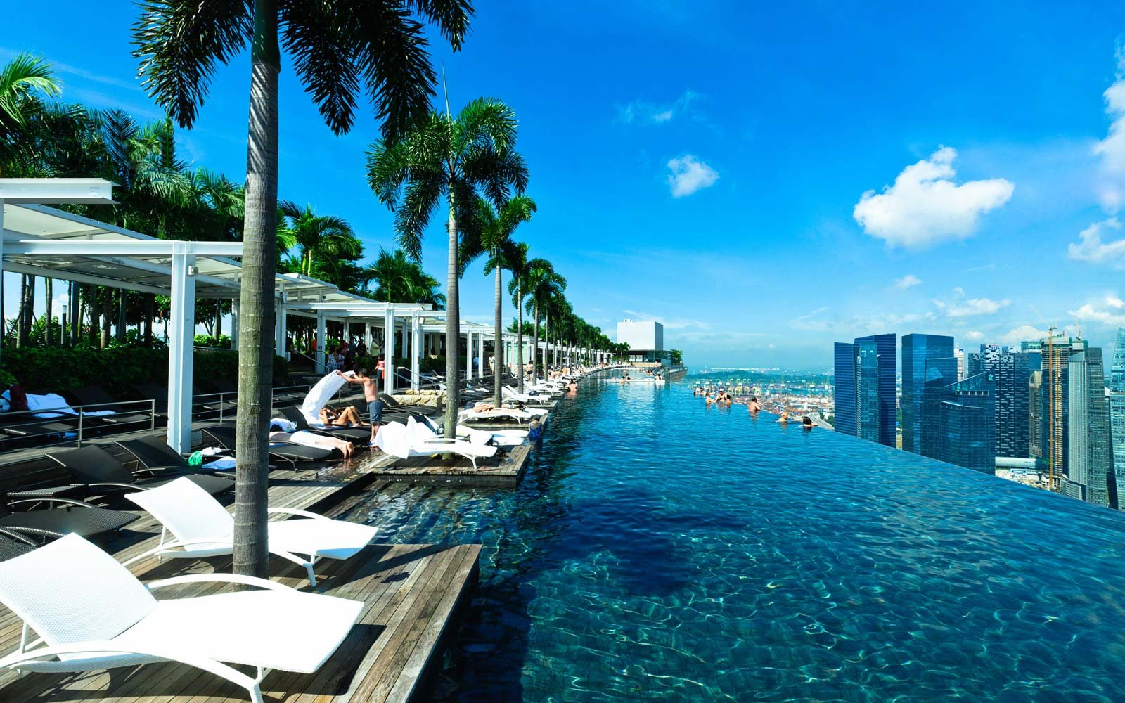 25 rooftop pools to dream about while you sit in the - Rooftop swimming pool in singapore ...