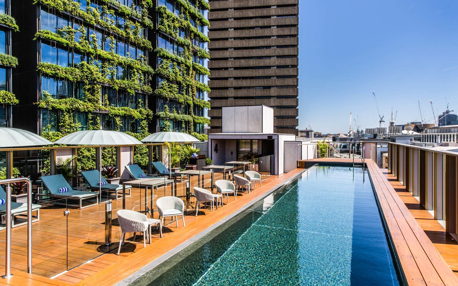25 rooftop pools to dream about while you sit in the office travel