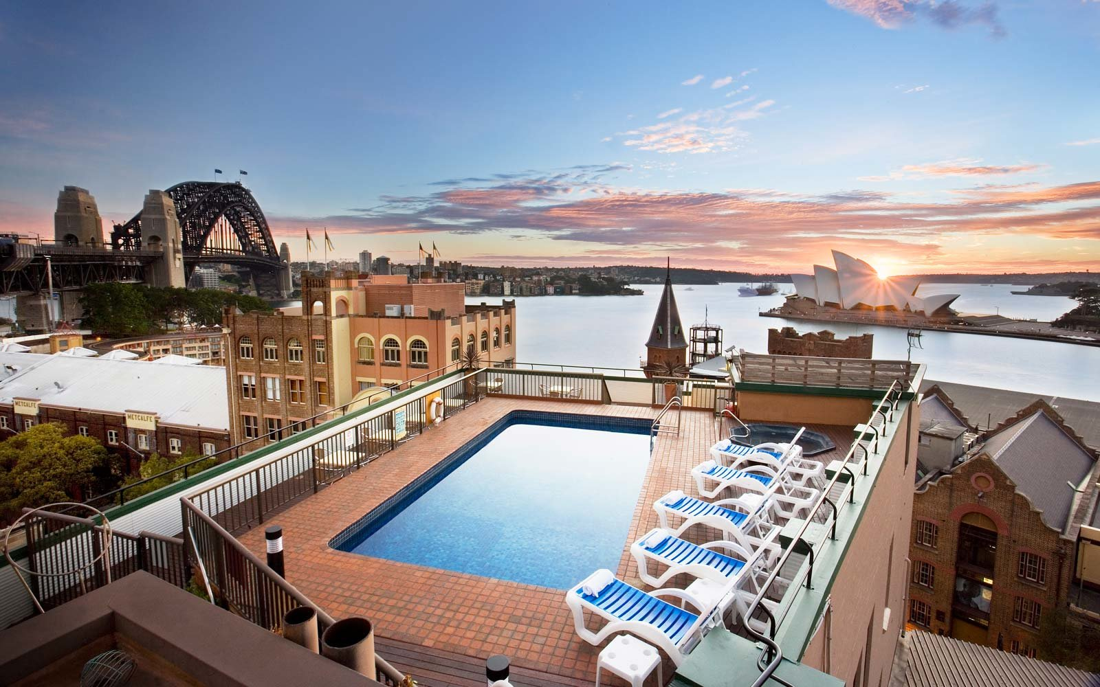 25 rooftop pools to dream about while you sit in the office travelholiday inn old sydney \u2014 sydney, australia