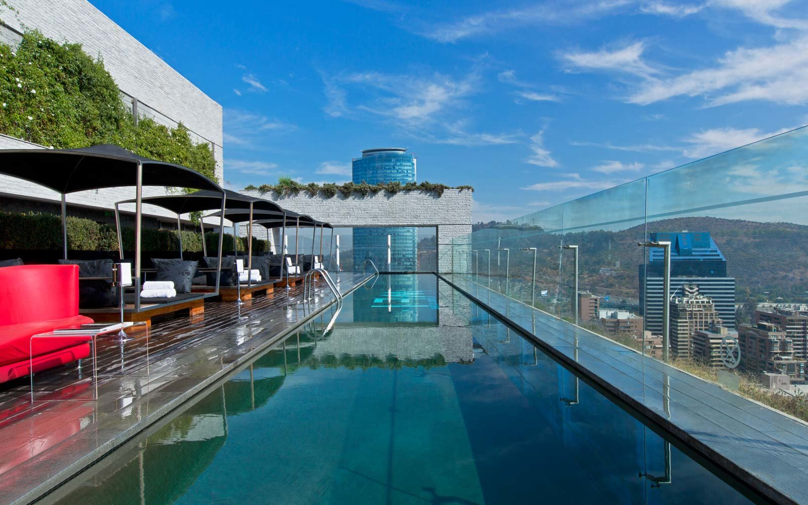 25 rooftop pools to dream about while you sit in the - Hotel new york swimming pool roof ...