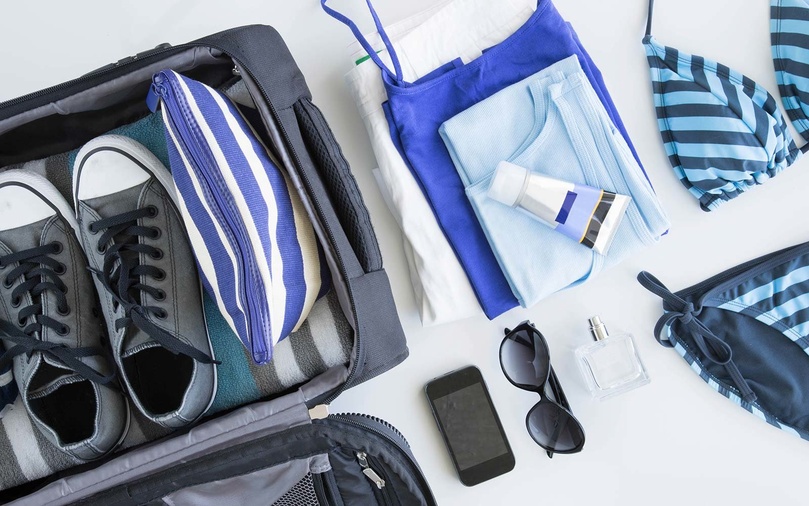 How To Pack Lighter Smarter And Faster Travel Leisure - Simple trick changes everything knew packing t shirts just brilliant
