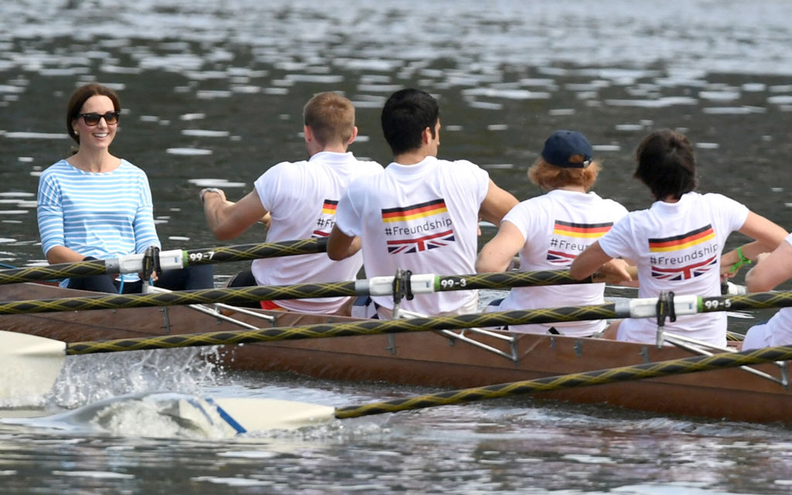 HEIDELBERG, GERMANY - JULY 20:  Catherine, Duchess of Cambridge participates in a rowing race between the twinned town of Cambridge and Heidelberg and against Prince William, Duke of Cambridge on day 2 of their official visit to Germany on July 20, 2017 i