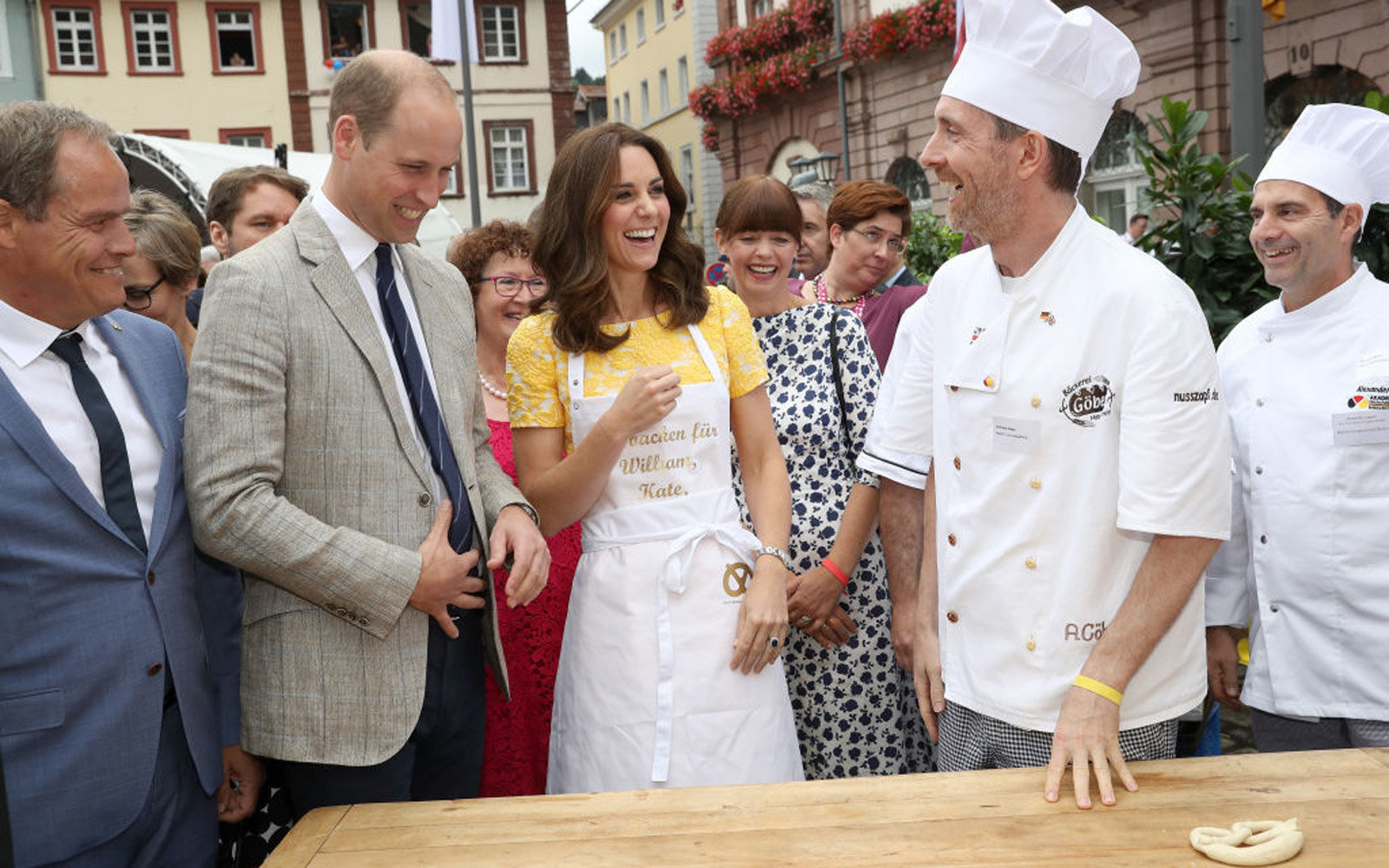 HEIDELBERG, GERMANY - JULY 20:  Prince William, Duke of Cambridge and Catherine, Duchess of Cambridge are shown how to make pretzels during a tour of a traditional German market in the Central Square on day 2 of their official visit to Germany on July 20,