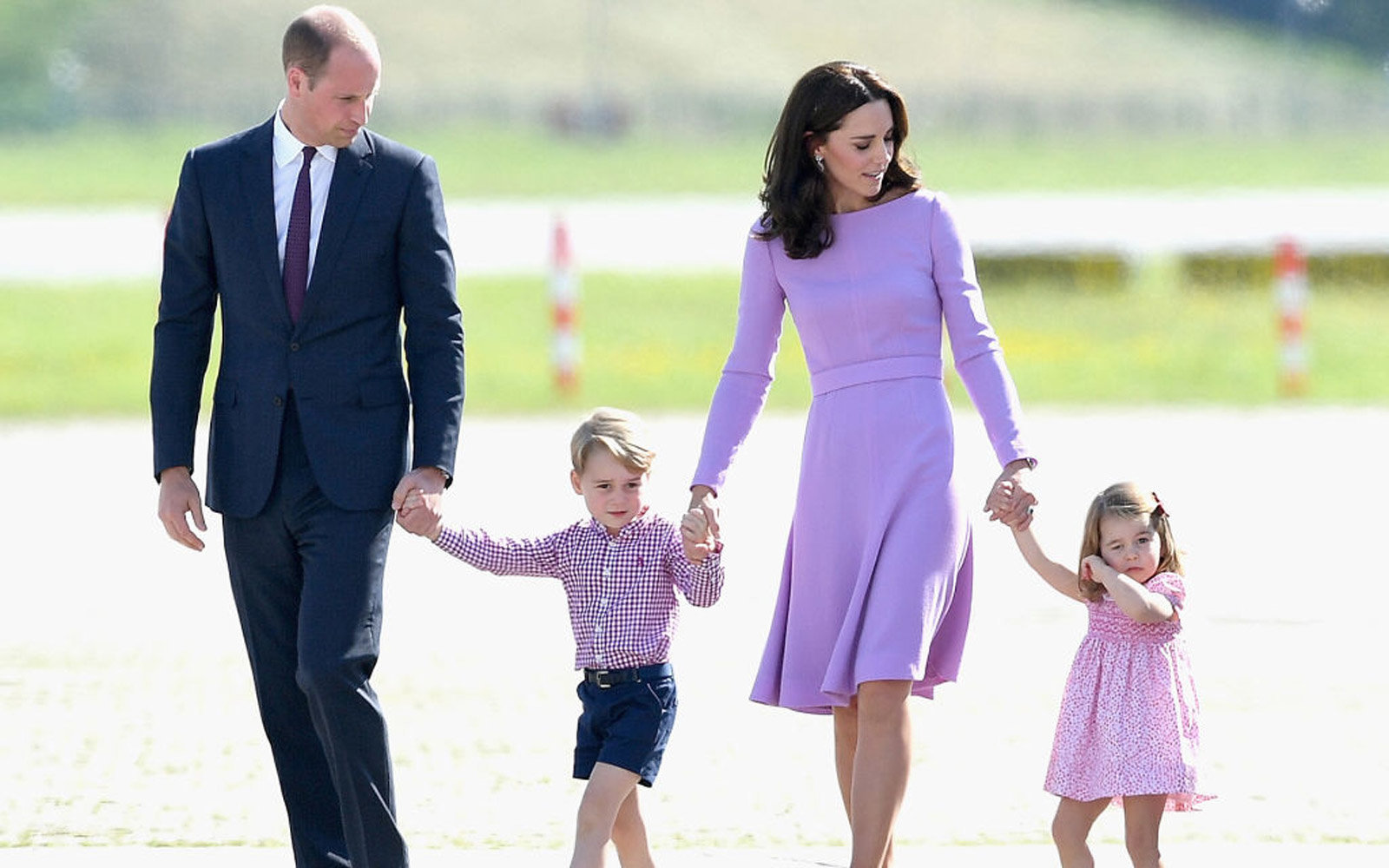 HAMBURG, GERMANY - JULY 21:  Prince William, Duke of Cambridge, Catherine, Duchess of Cambridge, Prince George of Cambridge and Princess Charlotte of Cambridge view helicopter models H145 and H135 before departing from Hamburg airport on the last day of t