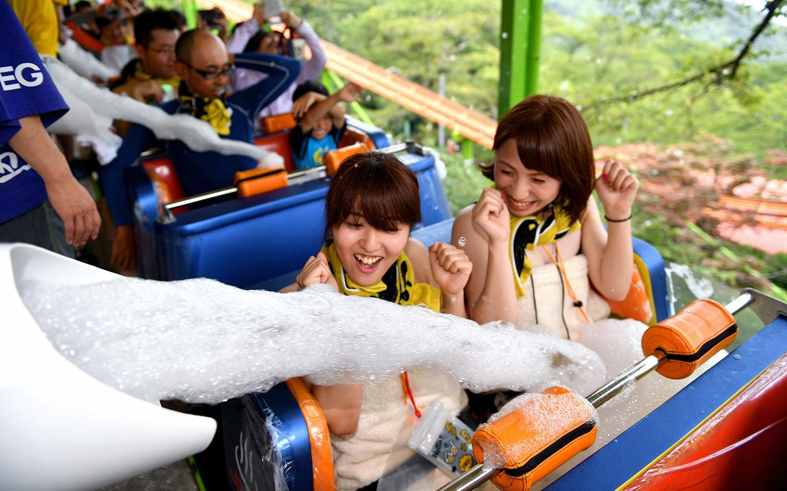"Visitors are splashed foam while riding a rollercoaster in ""Yu-enchi"" Spamusement park in Beppu, Oita, Japan Rakutenchi Hot Spring Onsen Theme Park"