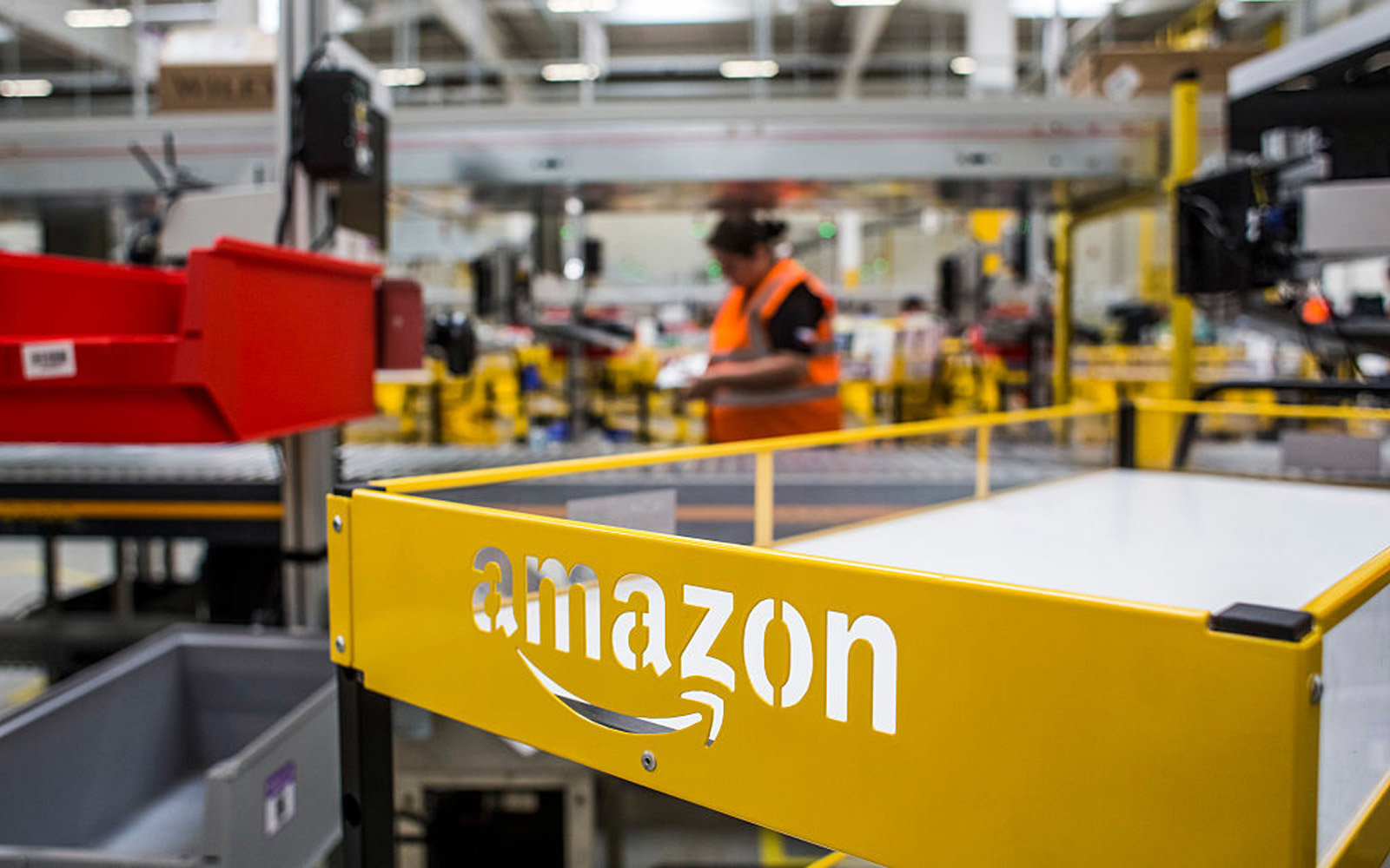 An empty cart stands in the distribution zone on the opening day of the new Amazon.Com Inc. fulfillment center in Dobroviz, Czech Republic, on Tuesday, Sept. 8, 2015. By the year 2018, 2,000 permanent and 3,000 seasonal workers will find a job at the ware