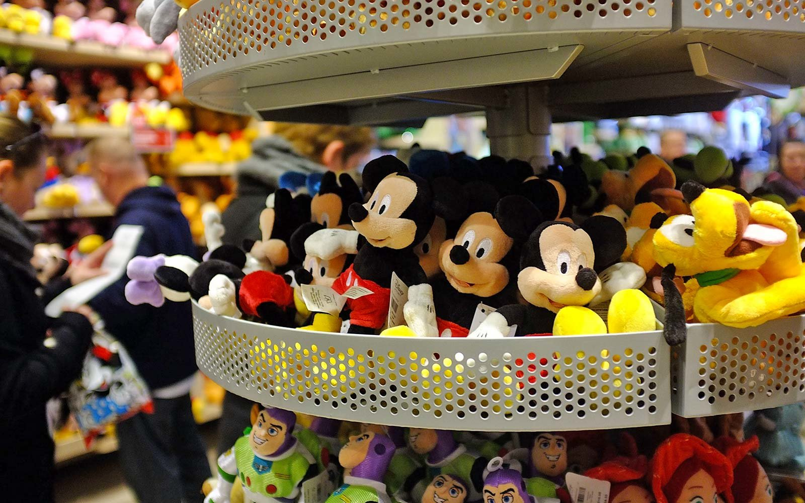 Stuffed toys are displayed at the Disney Store on in New York City retail jobs mickey mouse