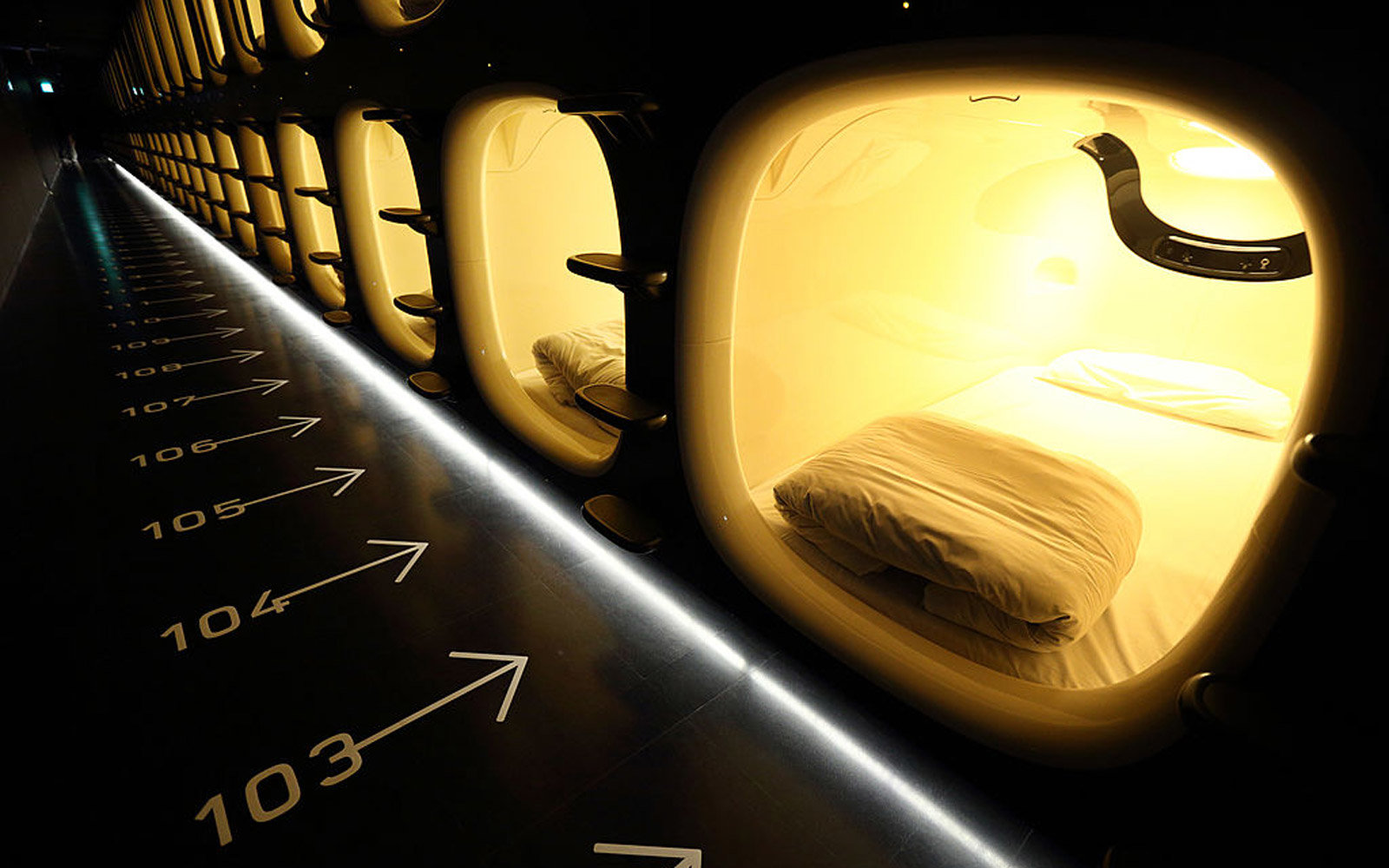 Capsule units stand in the Nine Hours Narita Airport capsule hotel, operated by nine hours Inc., at Narita Airport in Narita, Japan, on Thursday, July 31, 2014. The cheapest hotel in the Narita airport area was opened on July 20, offering a room which cos