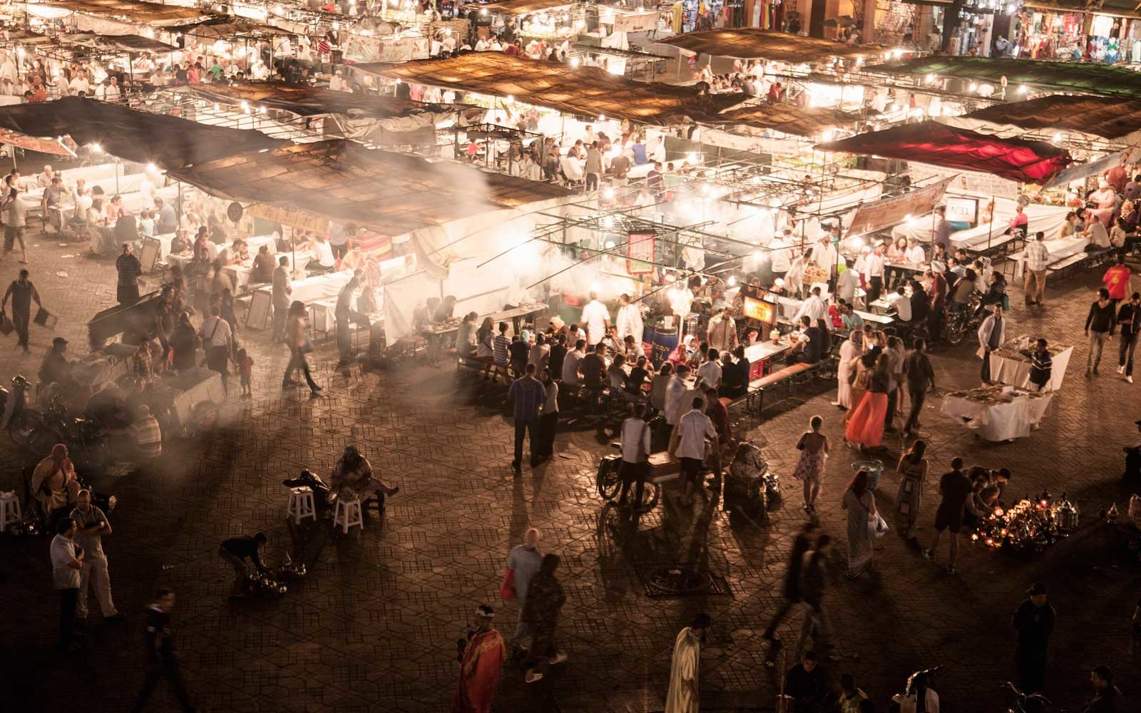 View of crowded market stalls at night, Jamaa el Fna Square, Marrakech, Morocco
