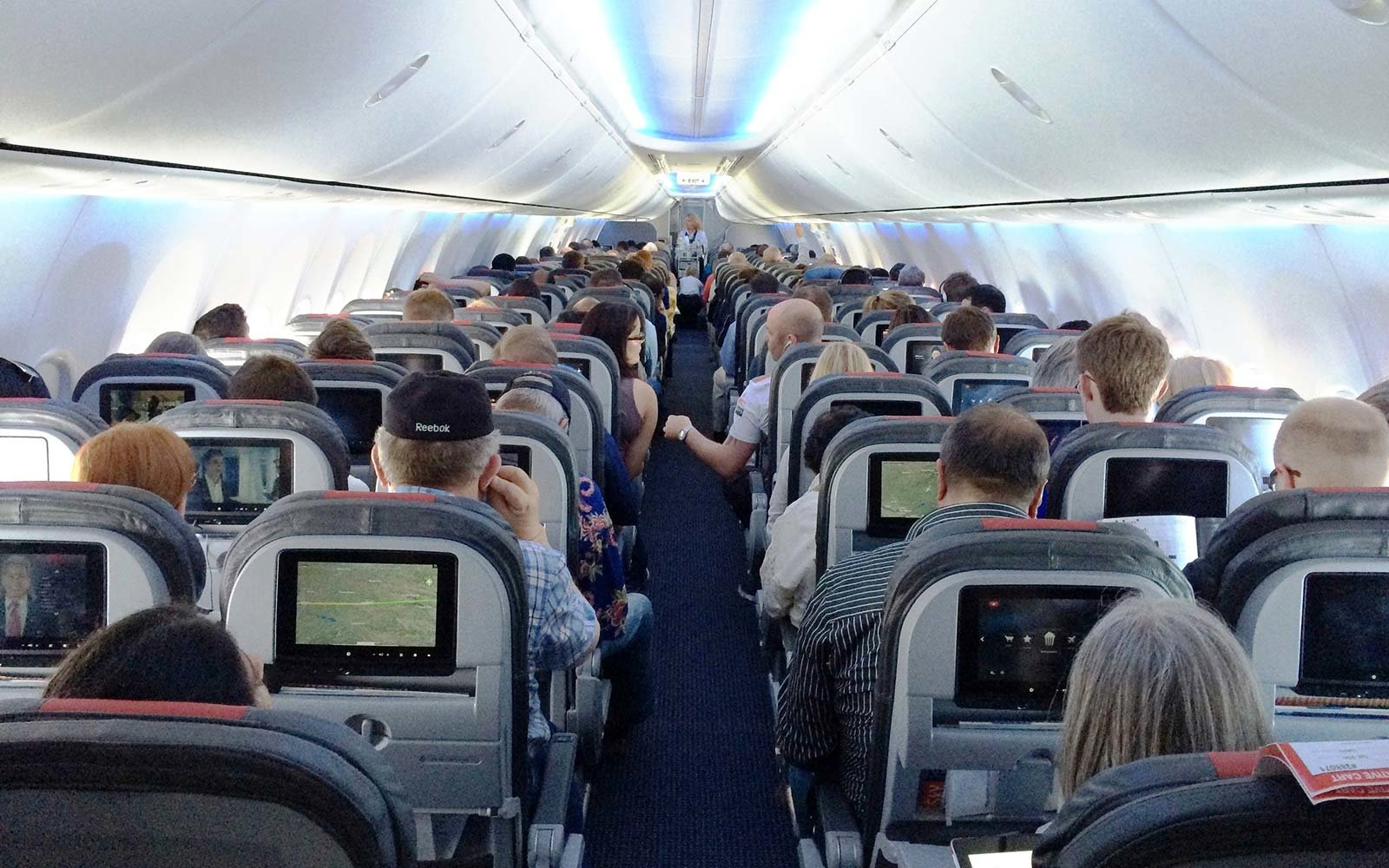 One of American Airlines' new 737s. The cabin gives standard economy passengers less space, but also an entertainment system to distract them