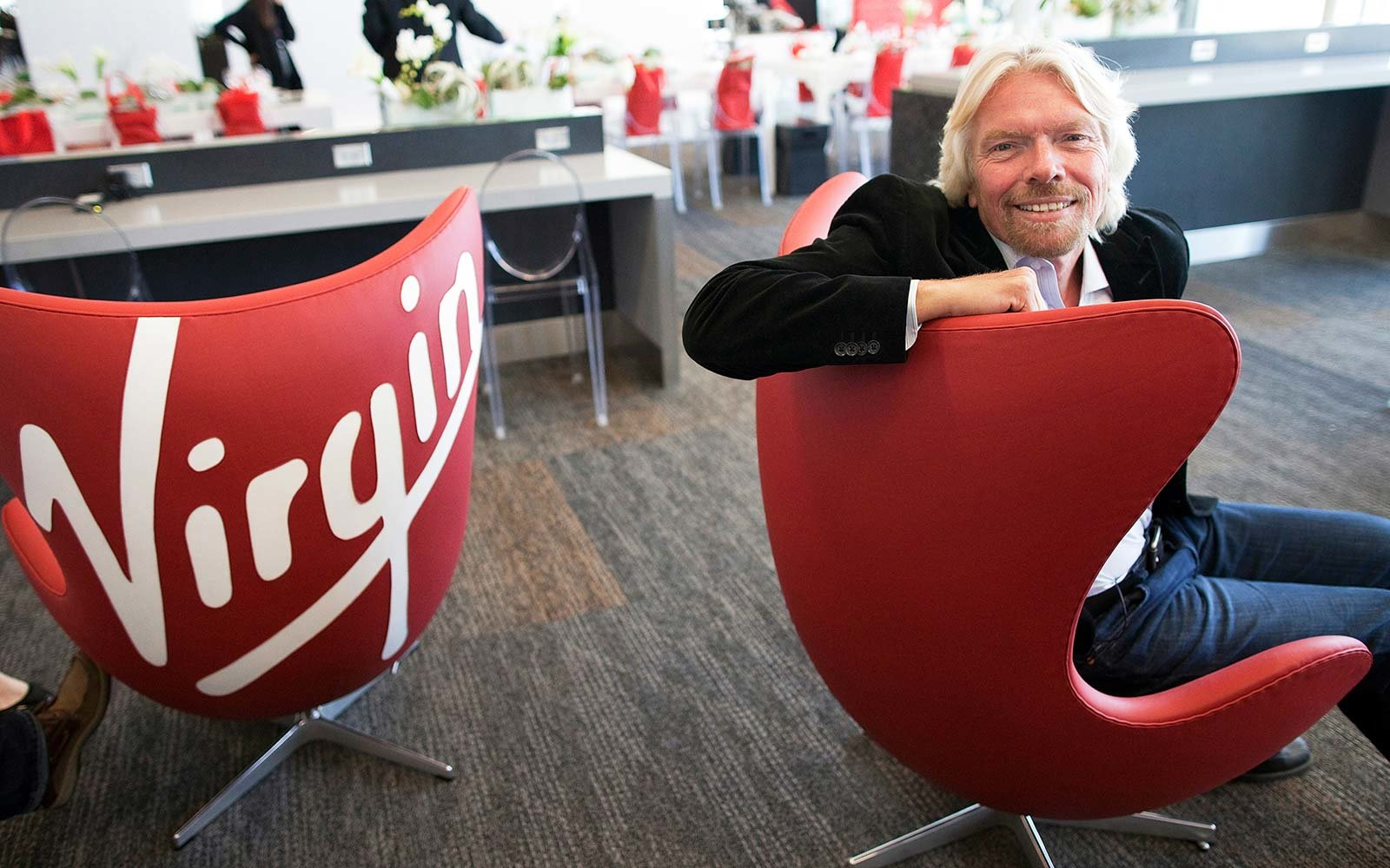 Richard Branson, founder and chairman of Virgin Group Ltd., sits for a photo at the new Terminal 2 at San Francisco International Airport in San Francisco, California, U.S. Virgin Atlantic