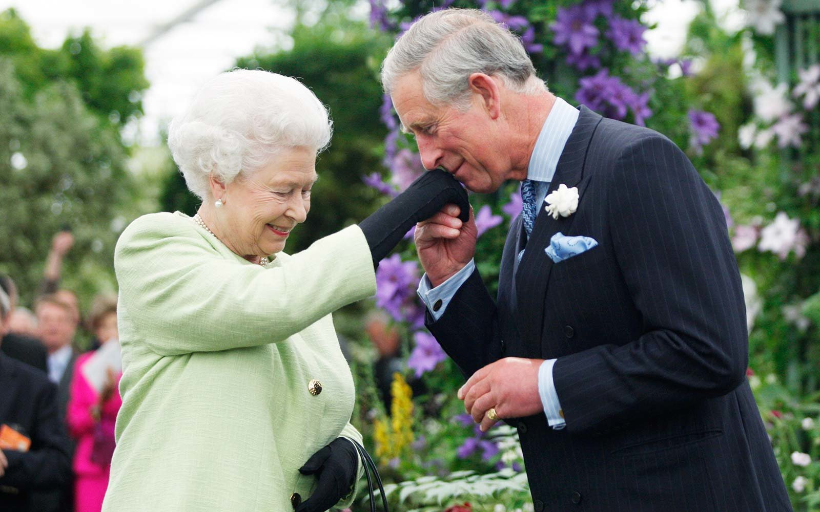Queen Elizabeth II presents Prince Charles, Prince of Wales with the Royal Horticultural Society's Victoria Medal of Honour during a visit to the Chelsea Flower Show in London