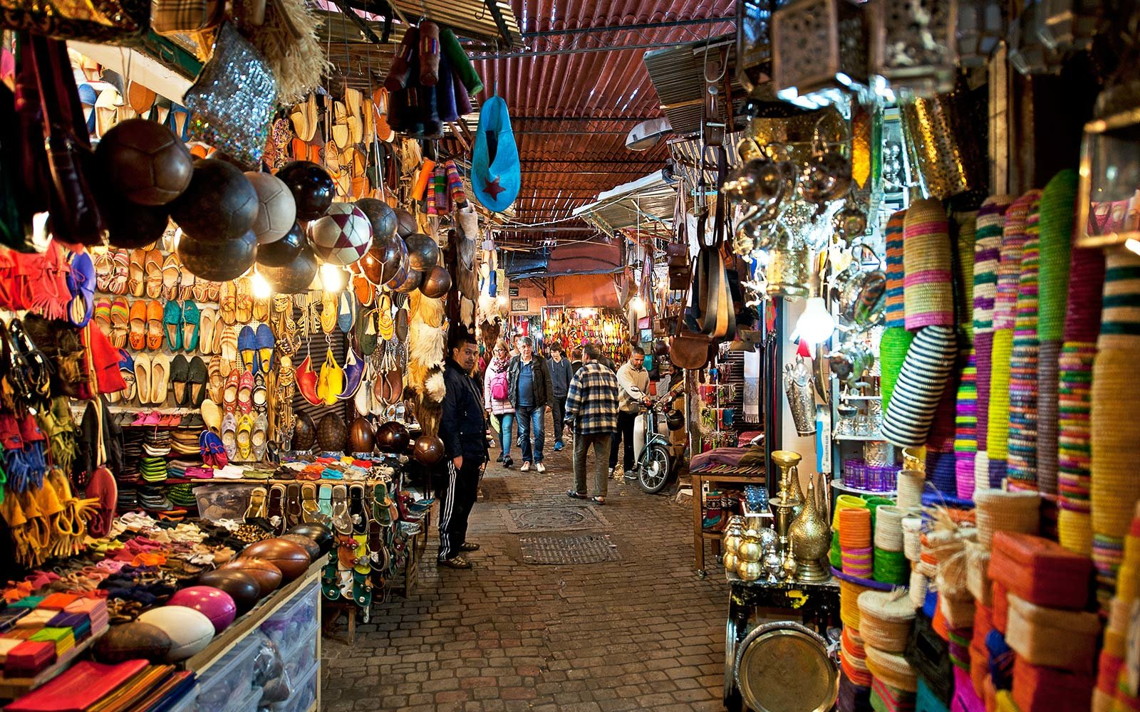 Moorish bazaar and narrow alleyways of the Souk, with a view into the market areas showing the incredible variety of wares for sale, Marrakech, Morocco
