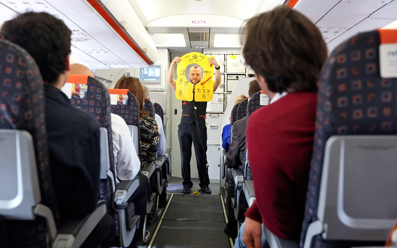 EasyJet flight attendant performs a safety demonstration United Kingdom