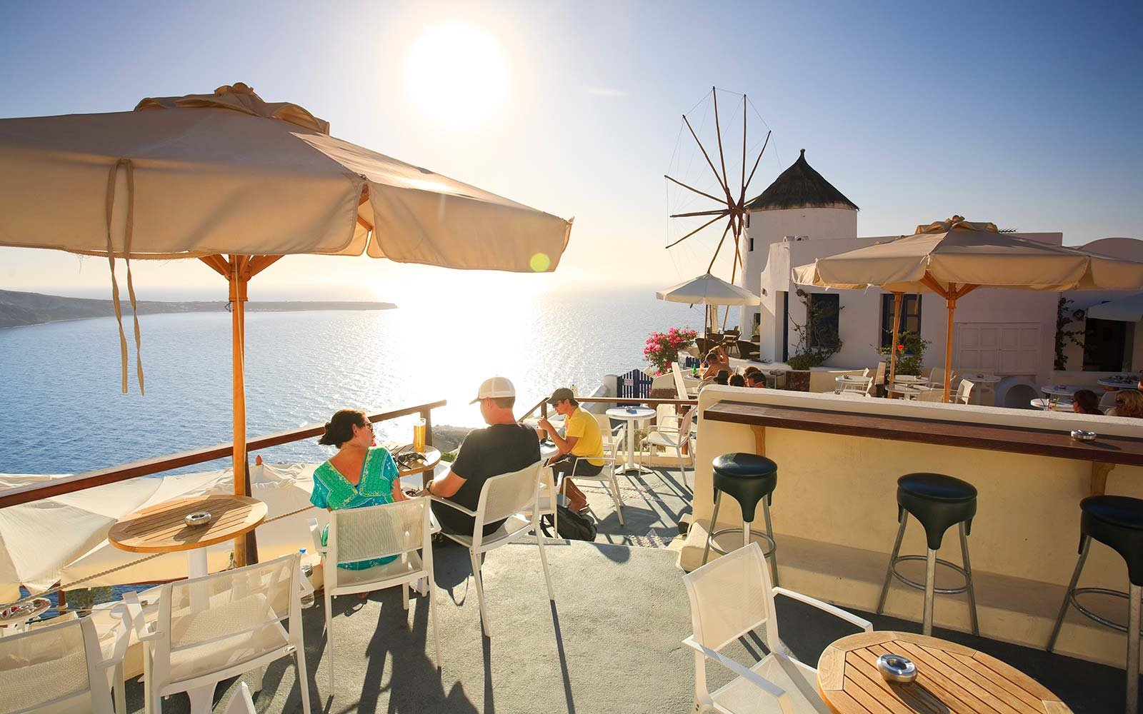 Greece, Cyclades, Santorini, Oia Town, outdoor cafe hotel Off Peak Holiday Vacation Hotel Booking Travel