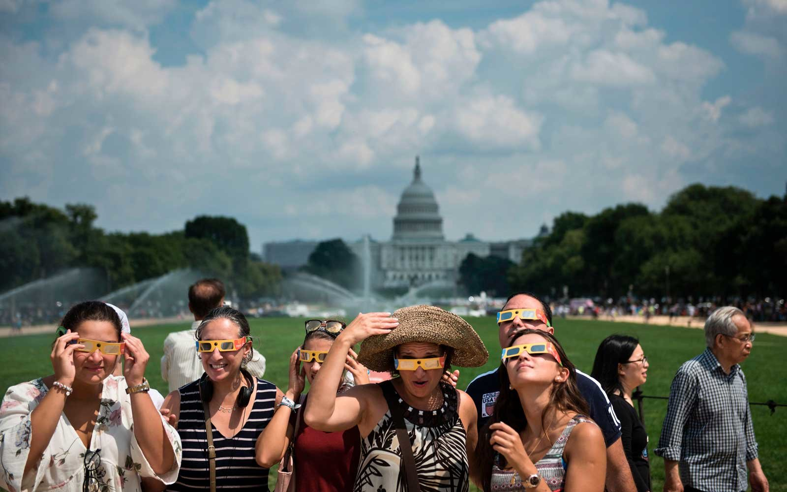 People pose for a selfie during an eclipse on the National Mall August 21, 2017 in Washington, DC