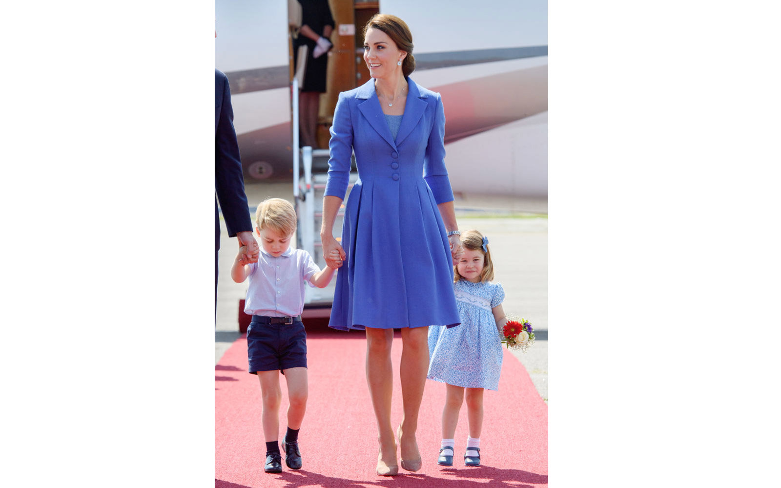 BERLIN, GERMANY - JULY 19:  (NO UK SALES FOR 28 DAYS FROM CREATE DATE) Catherine, Duchess of Cambridge, Prince George of Cambridge and Princess Charlotte of Cambridge arrive at Berlin military airport during an official visit to Poland and Germany on July