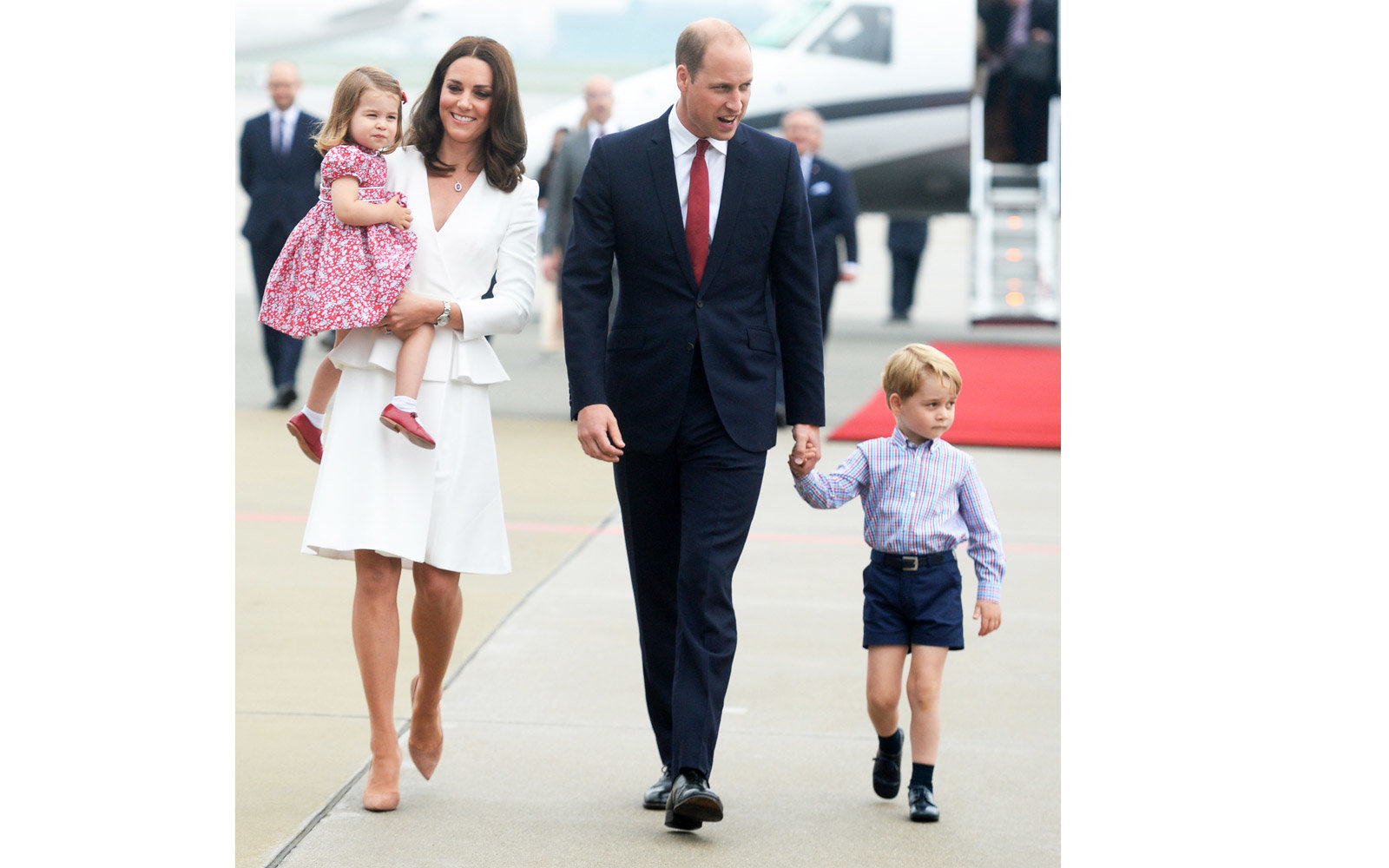 WARSAW, POLAND - JULY 17:  (NO UK SALES FOR 28 DAYS FROM CREATE DATE) Catherine, Duchess of Cambridge, Princess Charlotte of Cambridge, Prince William, Duke of Cambridge and Prince George of Cambridge arrive at Warsaw airport during an official visit to P