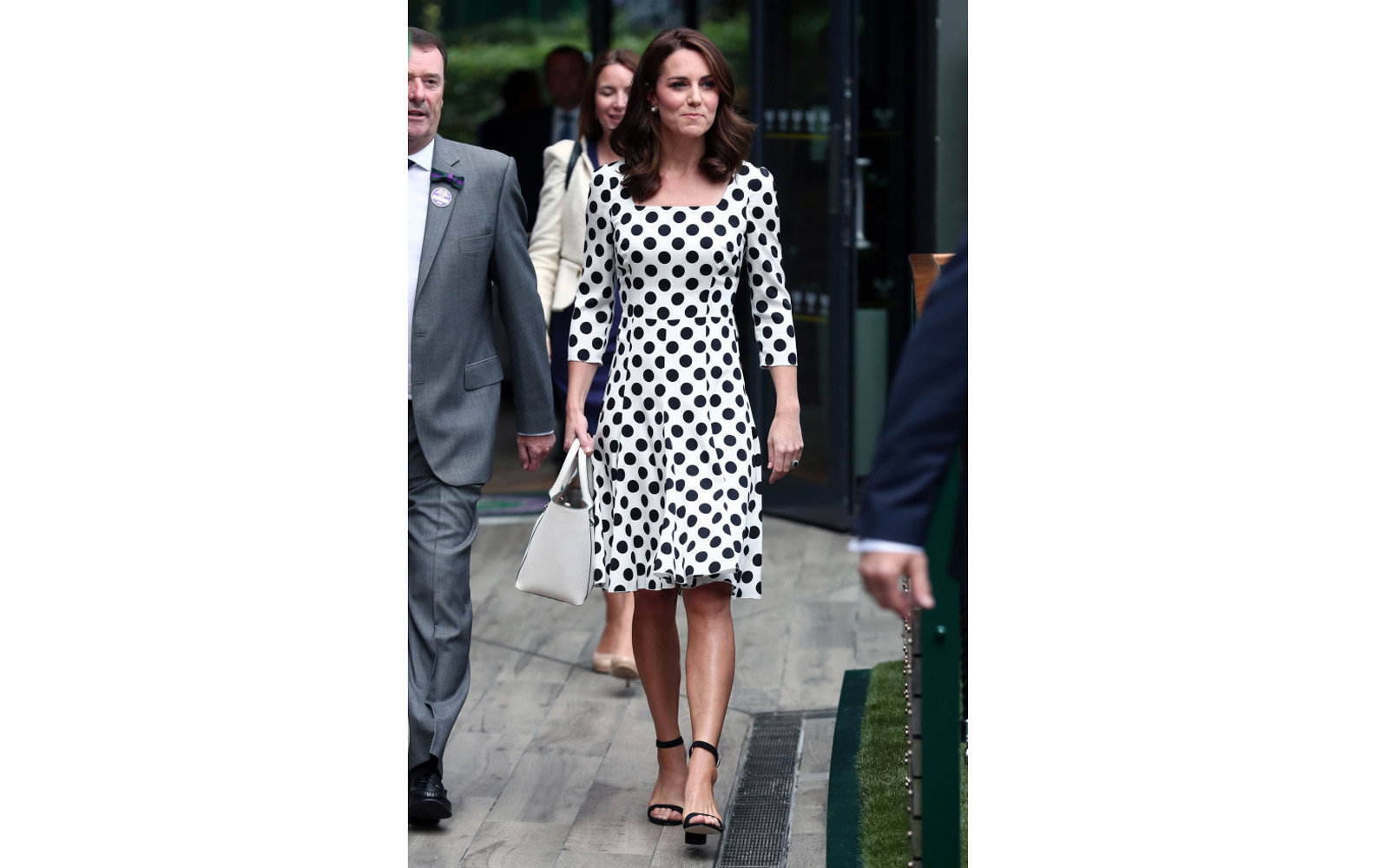 LONDON, UNITED KINGDOM - JULY 3:  Catherine, Duchess of Cambridge, Patron of the All England Lawn Tennis and Croquet Club (AELTC) with Philip Brook (left) on day one of the Wimbledon Championships at The All England Lawn Tennis and Croquet Club, in Wimble